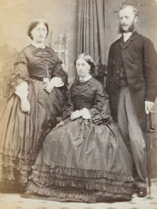 Thomas Bradney Shaw-Hellier with his sister Camilla Charlotte Augsuta Bradney Wing (seated) in mourning dresses, possible after death of their father in 1870