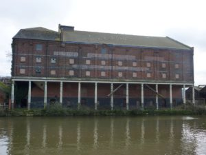 G. & W.E. Downing's Maltings, Docks, Gloucester, Feb 2017. The west side of the 'new' malthouses with pillars over the quay