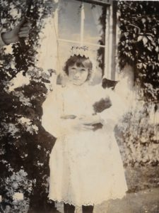 Molly Evans with Nanny's hand holding umbrella, The Lawn, Hagley, c. 1895