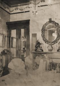 Dining room in Nelly's house, possibly at 2 Morshead Mansions, Maida Vale, c. 1905
