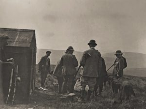 James, a gamekeeper (second left) and W.E. Downing (far right). Shooting at the Beacon, c. 1910
