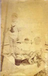 Hal Lewis, Molly Evans and WIlmot Evans on the beach about 1893