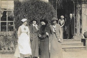Molly Evans with friends, sister Phyllis (fourth left) and parents, The Lawn, Hagley, 1914