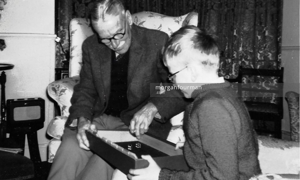 Noel Downing with his grandson Jonathan, The Cottage, Upton, Hampshire, Christmas 1964