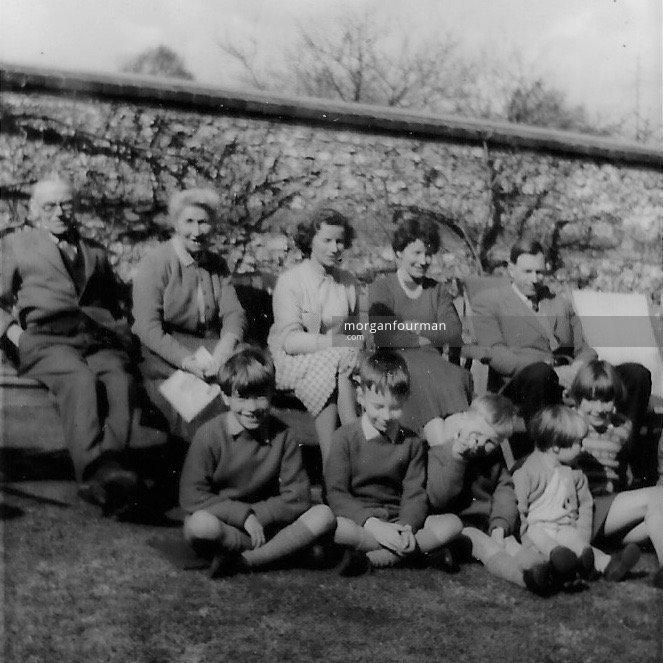 Noel & Molly Downing, daughters Pam & Hazel, Stephen, grandchildren Christopher, David, Jonathan, Juliet & Anna, The Cottage, Upton, c. 1962