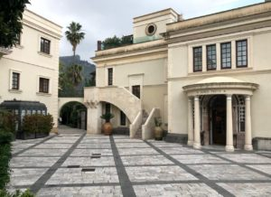 Front porch with staircase to minstrels' gallery and first floor (left) and foundation stone (right), The Ashbee Hotel, Taormina, 2018