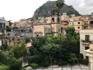"""View of courtyard and Church of San Pancrazio, The Ashbee Hotel, Taormina, 2018. Taken from the same viewpoint as the Gloeden's """"A garden under construction"""""""