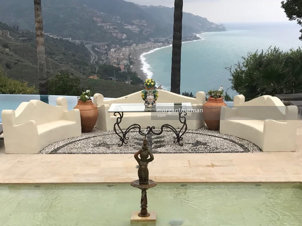 View over Greek seat to Capo Sant'Alessio, The Ashbee Hotel, Taormina, 2018. Taken from the same viewpoint as the Gloeden's photograph of Col. T.B. Shaw-Hellier watering his garden