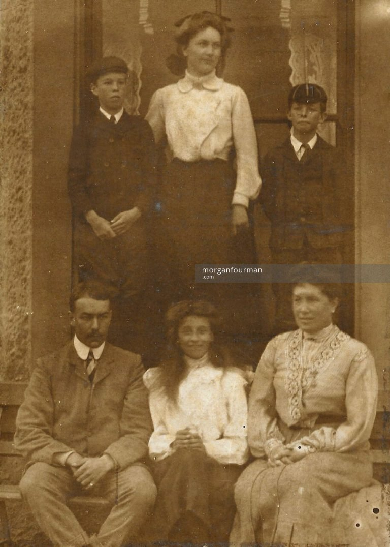 Standing Edith Mathews between two schoolboys. Seated Jim Mathews, Molly Evans and Mrs Mathews