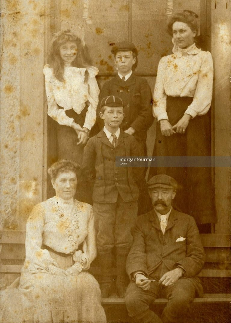 Standing l-r: Molly Evans, Schoolboys, Edith Turney Mathews. Seated Mrs and Mr Randle Mathews of Stourton Court