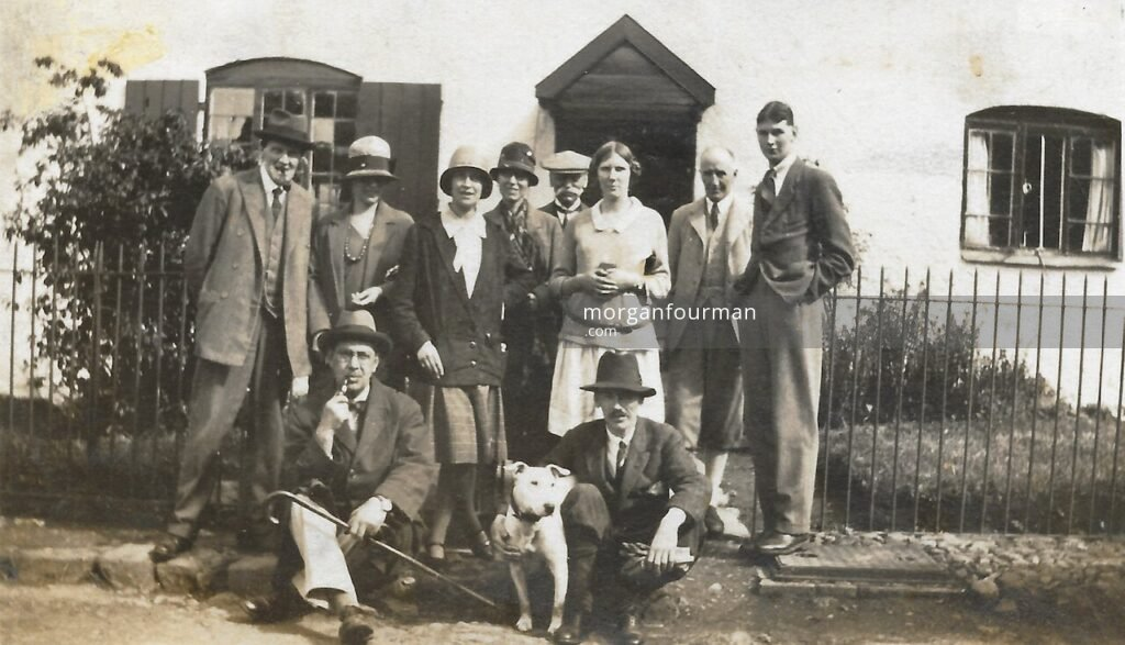 Manor House, Ratlinghope, c.1925. Back row: Willie G, Daisy?, Molly, ?, WED, Nancy, ? and Jack Grazebrook; Front row: ?, Crib the dog, Noel