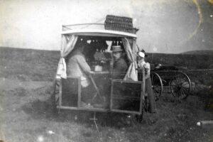 Thomas Lee Downing in the back of the wagon, Noel leaning out the side, Ratlinghope, 1899